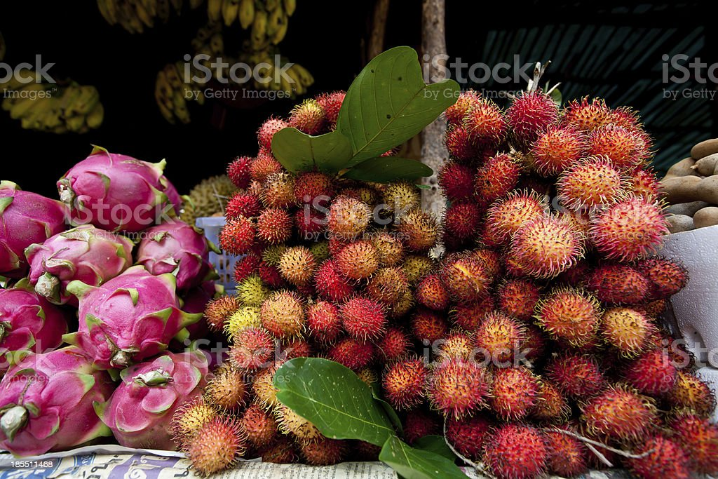 Close-up of Dragon Fruit and Rambutan in Market royalty-free stock photo