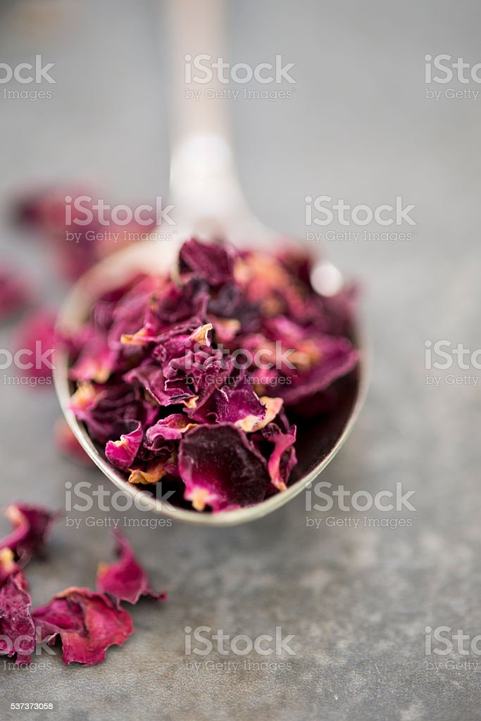 Close-up of Dried Rose Petals on Spoon stock photo