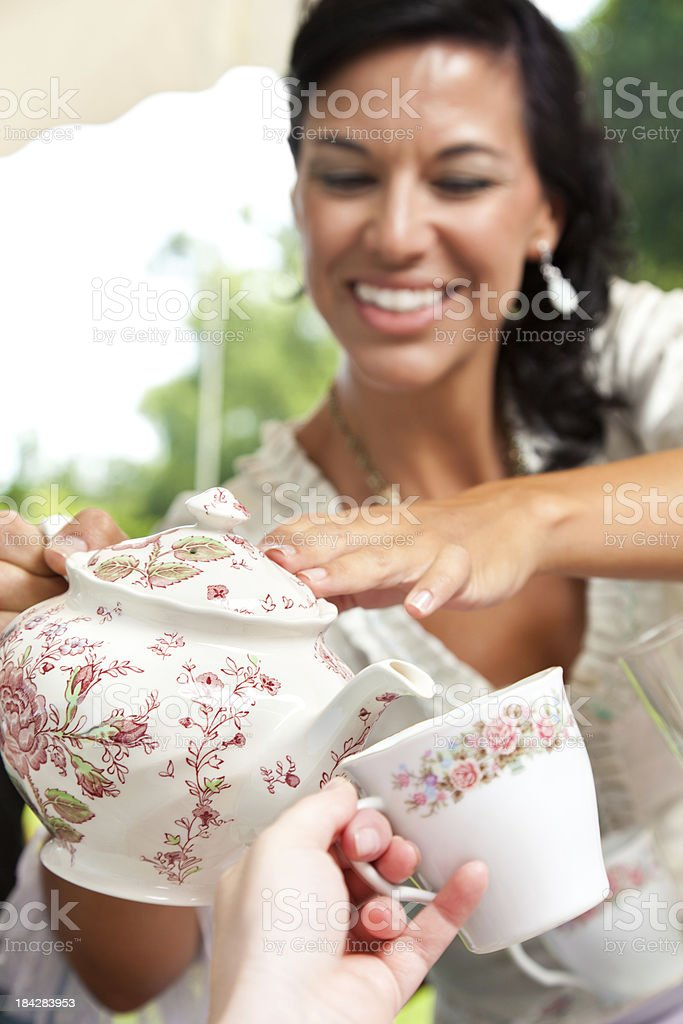 Closeup of Drink Being Poured By Woman at Tea Party royalty-free stock photo