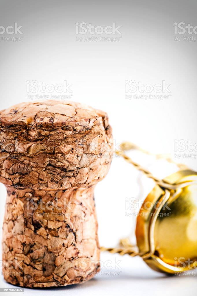 Close-up of drinks utensil beer cork and gold metallic twisted muselet isolated on white background in studio bottle stopper stock photo