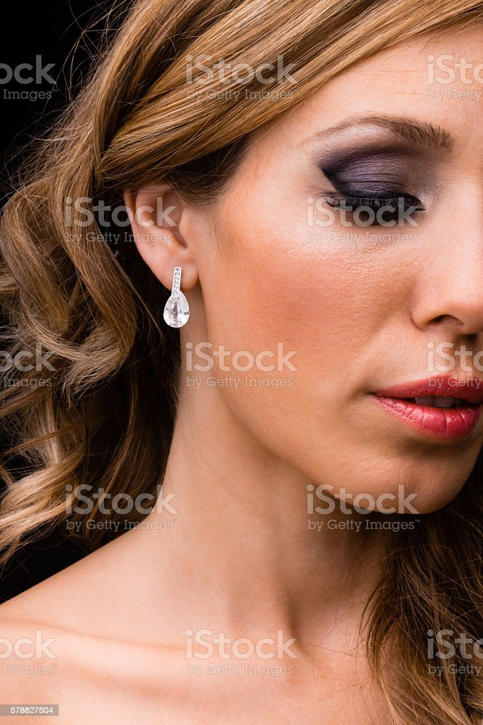 Close-up of earing on woman's ear stock photo