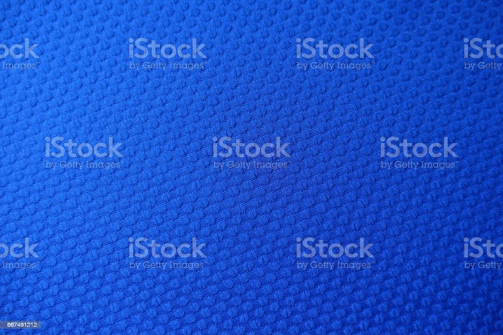 Close-up of electric blue jacquard fabric from above stock photo