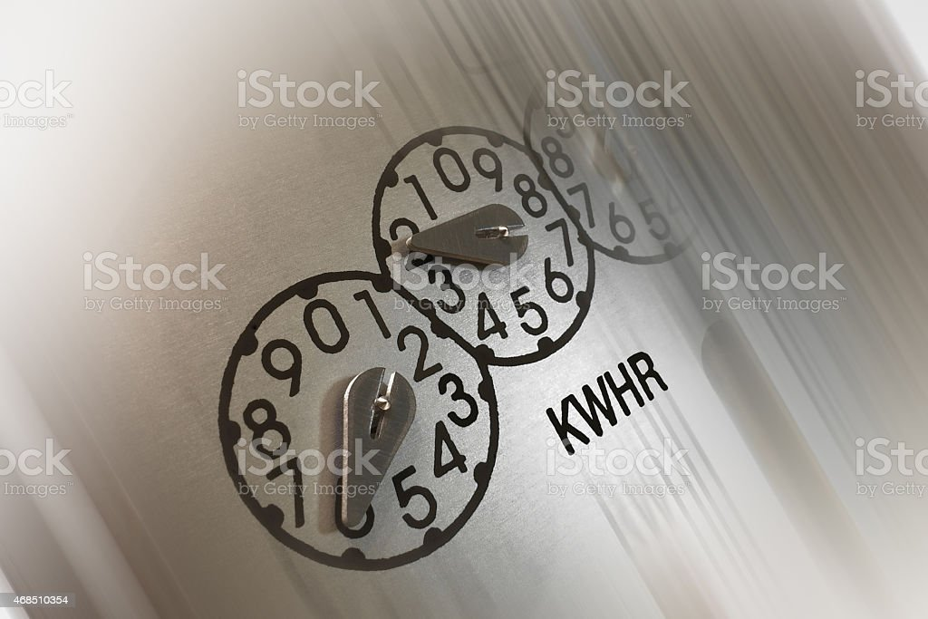 Close-up of electric meter kilowatt-hour dials with abbreviated symbols KWHR stock photo