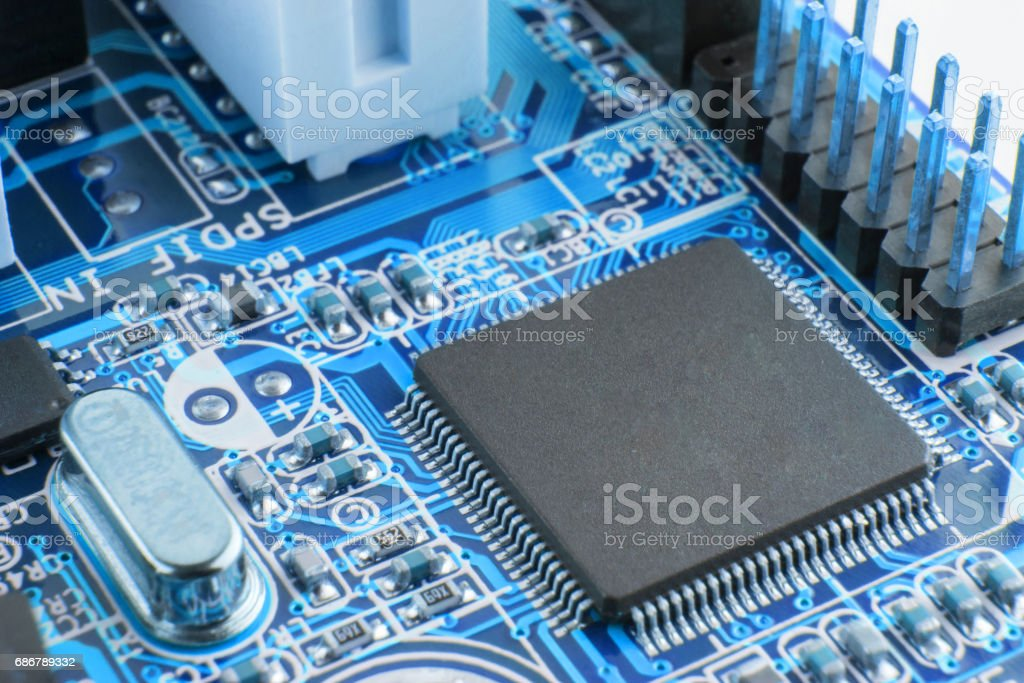 Close-up of electronic circuit board with processor. stock photo