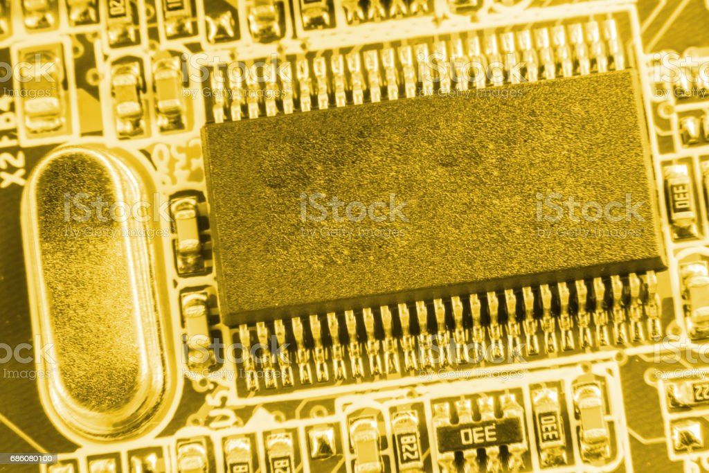 Close-up of electronic circuit board with processor toned. stock photo