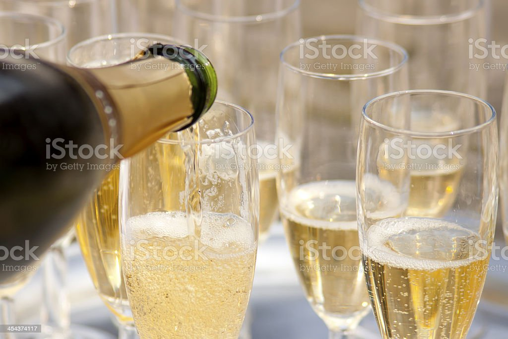 Close-up of elegant glasses filled with champaign stock photo