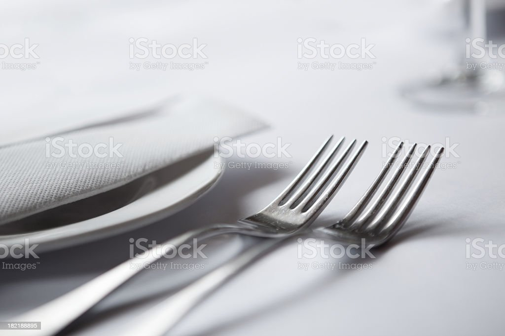 A close-up of elegant table setting with two forks stock photo