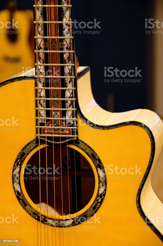 Closeup of elements of  a six strings guitar with dark background stock photo