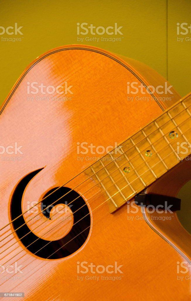 Closeup of elements of six strings guitar with olive background stock photo