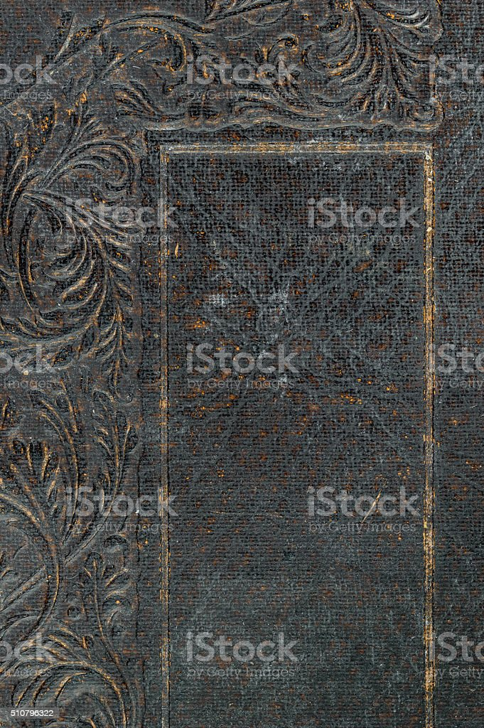 Close-up of embossed distressed vintage book cover. stock photo