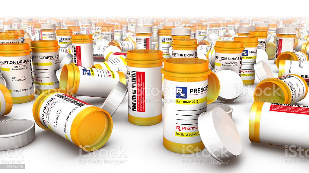 Close-up of empty pill bottles (fallen at side) stock photo