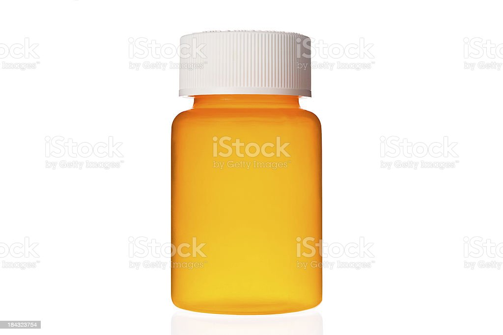 Close-up of empty unlabelled orange pill bottle on glass stock photo
