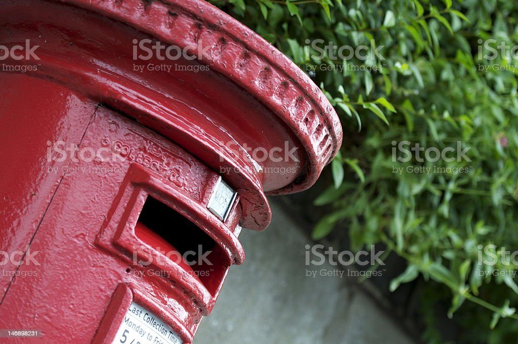 Close-up of English red post box mail drop opening stock photo
