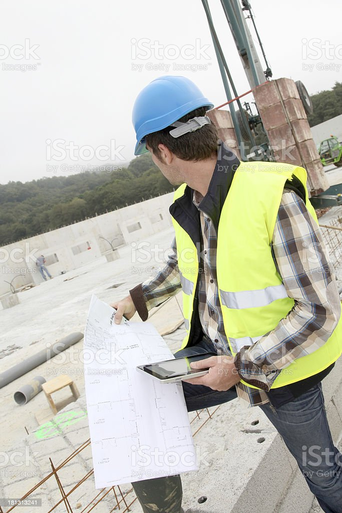 Closeup of entrepreneur working in construction site royalty-free stock photo