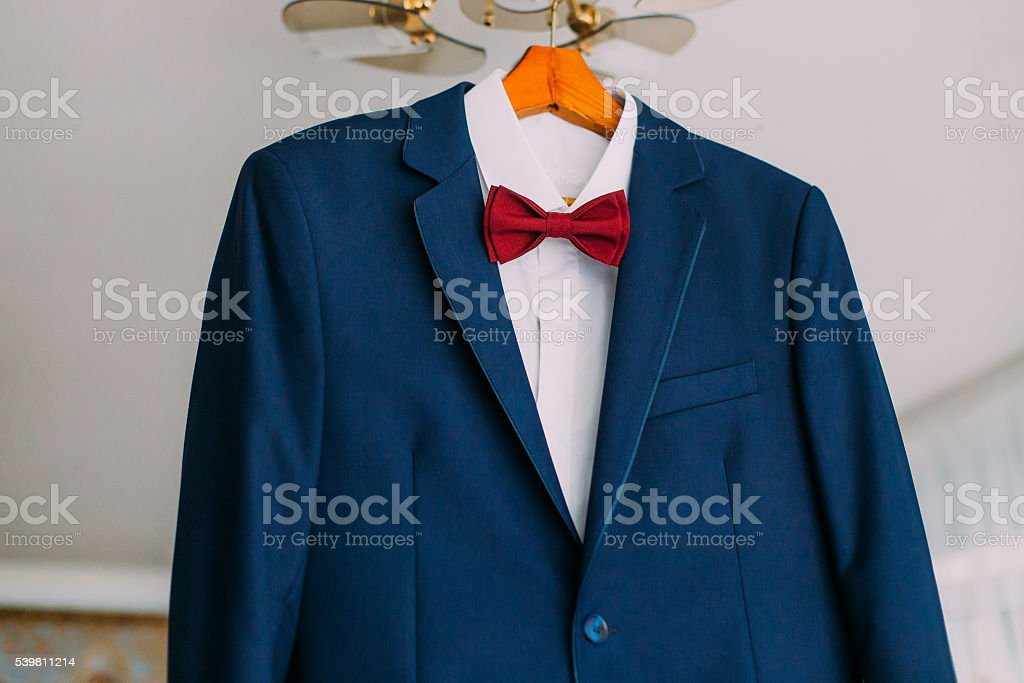 Close-up of excellent expensive blue suit with red bow stock photo