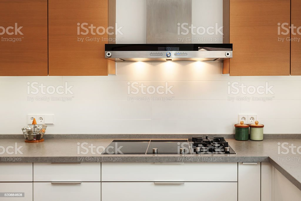 Closeup of exhaust hood and ceramic cooking plate stock photo