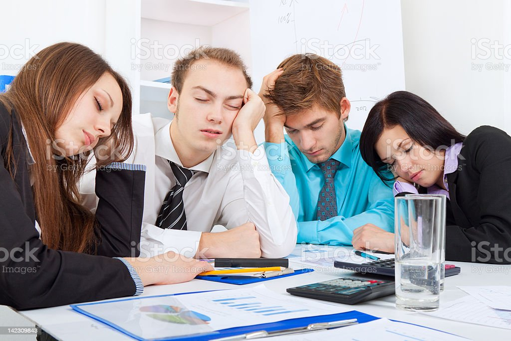 Close-up of exhausted business team after project royalty-free stock photo