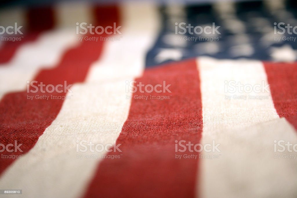 Closeup of fabric American flag with blurred vignette stock photo