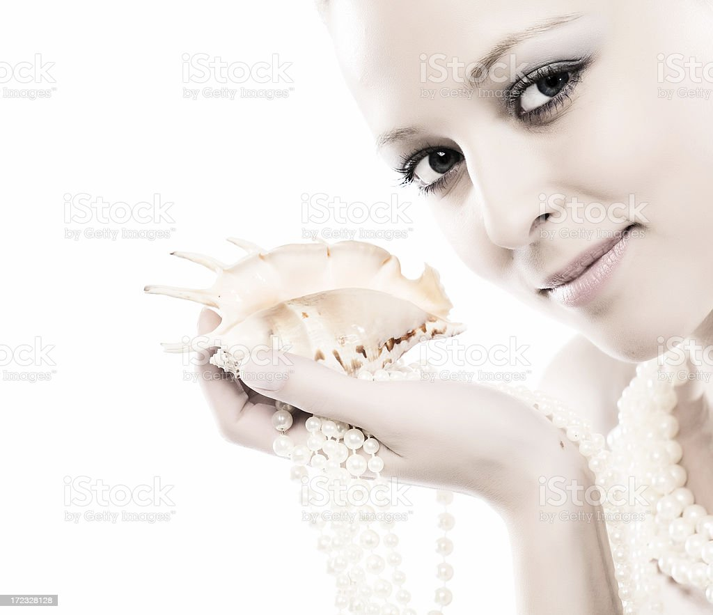 Close-up of face with cockle-shell and pearls stock photo