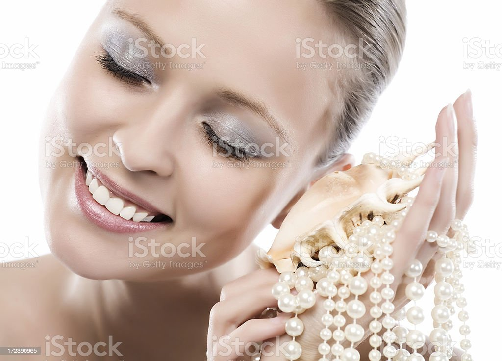 Close-up of face with cockle-shell and pearls royalty-free stock photo