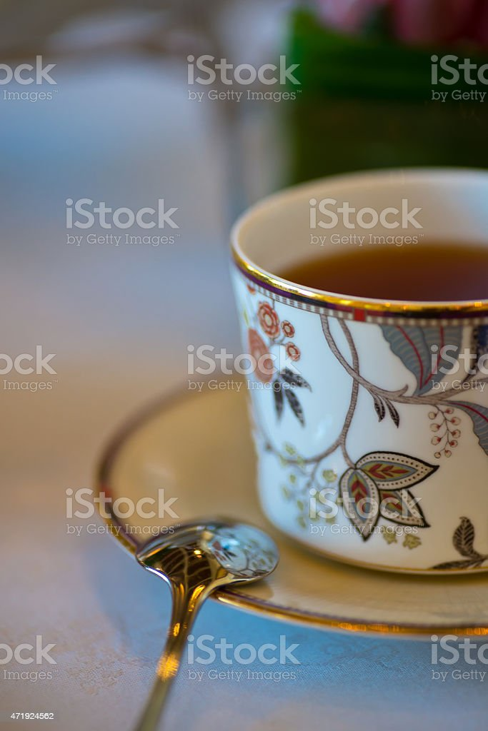Closeup of fancy decorative antique tea cup and spoon stock photo