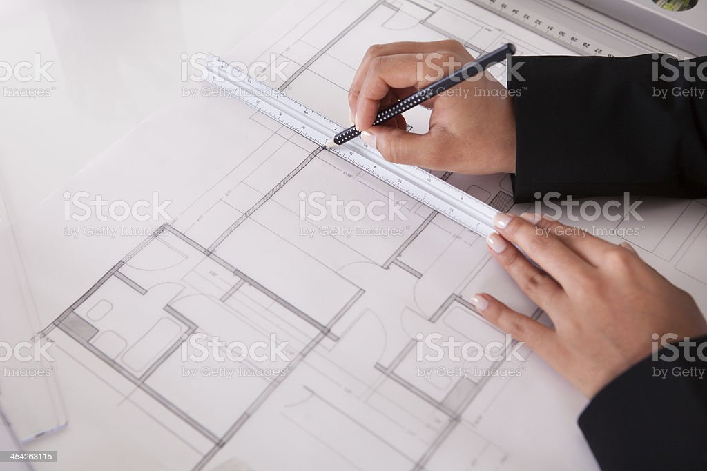 Close-up Of Female Architect Drawing Blueprint royalty-free stock photo