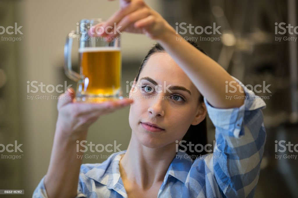 Close-up of female brewer testing beer stock photo