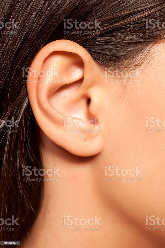 Close-up of female ear stock photo