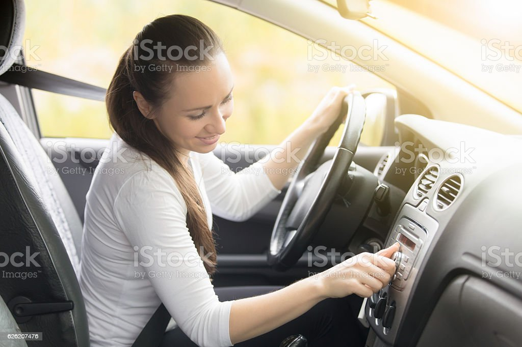 Close-up of female hand starting a car stock photo