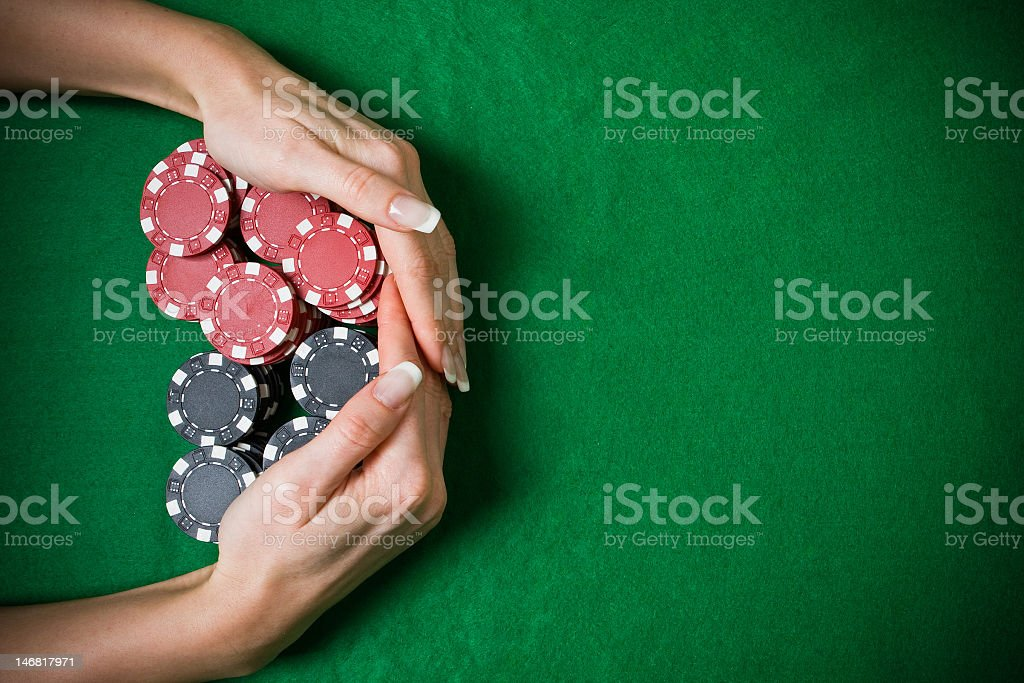 A closeup of female hands taking the jackpot from the table stock photo