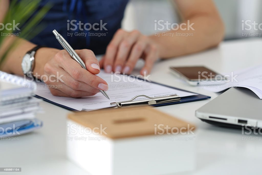 Close-up of female hands working at office stock photo