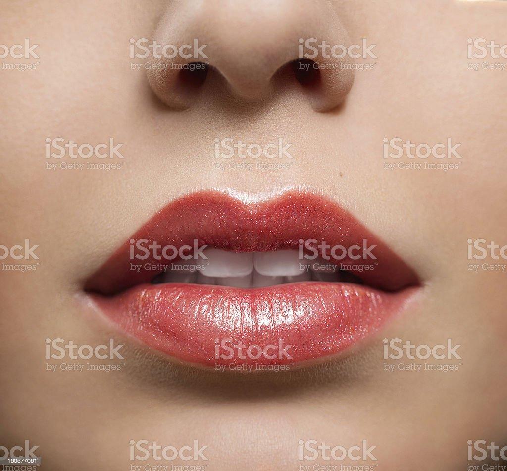 Close-up of female lips wearing glossy lipstick stock photo