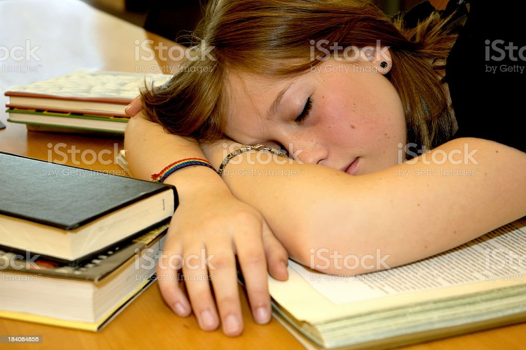 Close-up of female student sleeping on books royalty-free stock photo