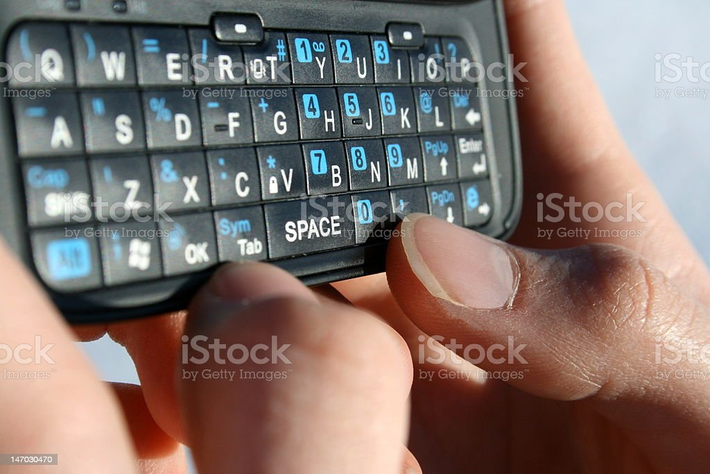 Close-Up of Female Texting royalty-free stock photo