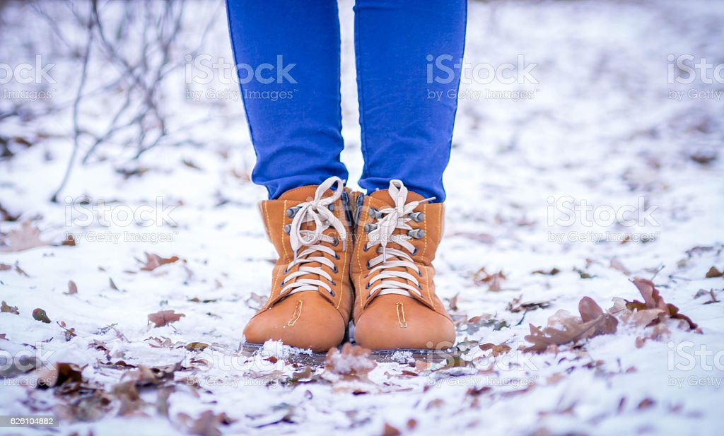Closeup of female winter shoes stock photo