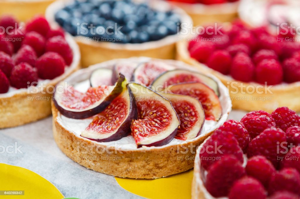 Closeup of fig tart dessert tray assorted stock photo