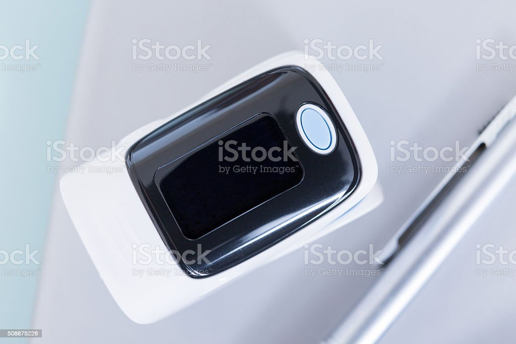 Close-up of finger pulse oximeter stock photo