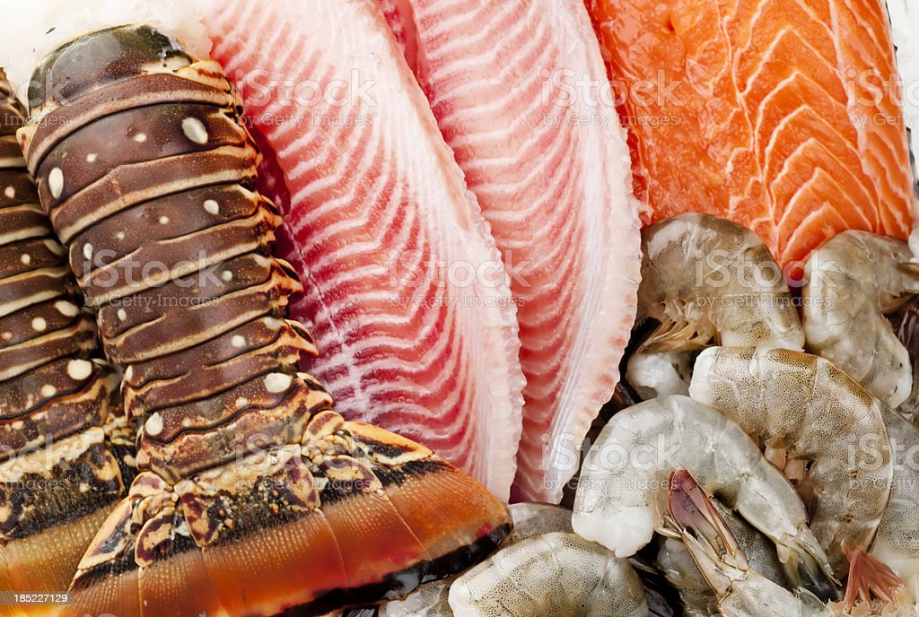 Closeup of fish, shrimp and lobsters on ice stock photo