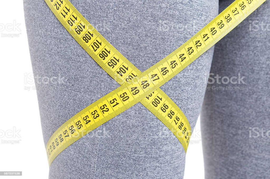 Close-up of fit leg with tape line around stock photo