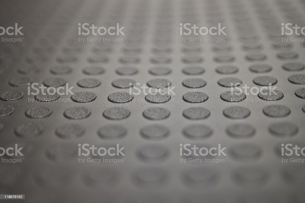 Closeup of Floormat With Coin Shapes XL royalty-free stock photo