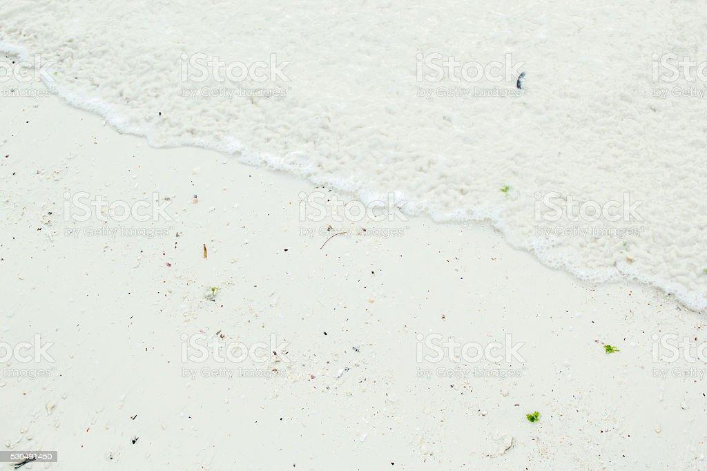 Close-up of foam waves on coastline stock photo