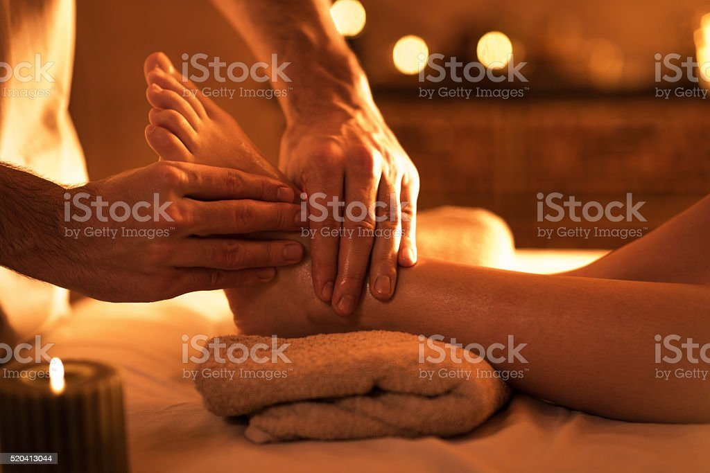 Close-up of foot massage at the spa. stock photo
