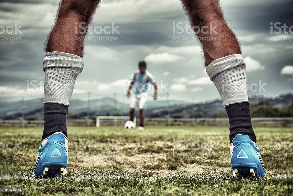 Close-up of football goalkeeper's hairy legs royalty-free stock photo