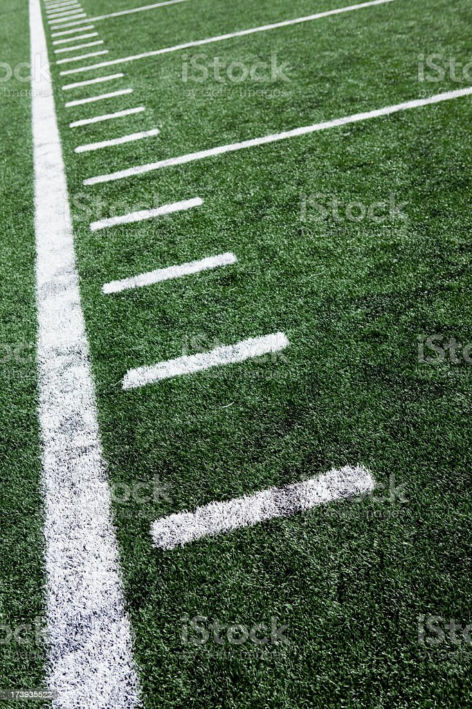 Close-up of football stadium markings on artificial grass royalty-free stock photo