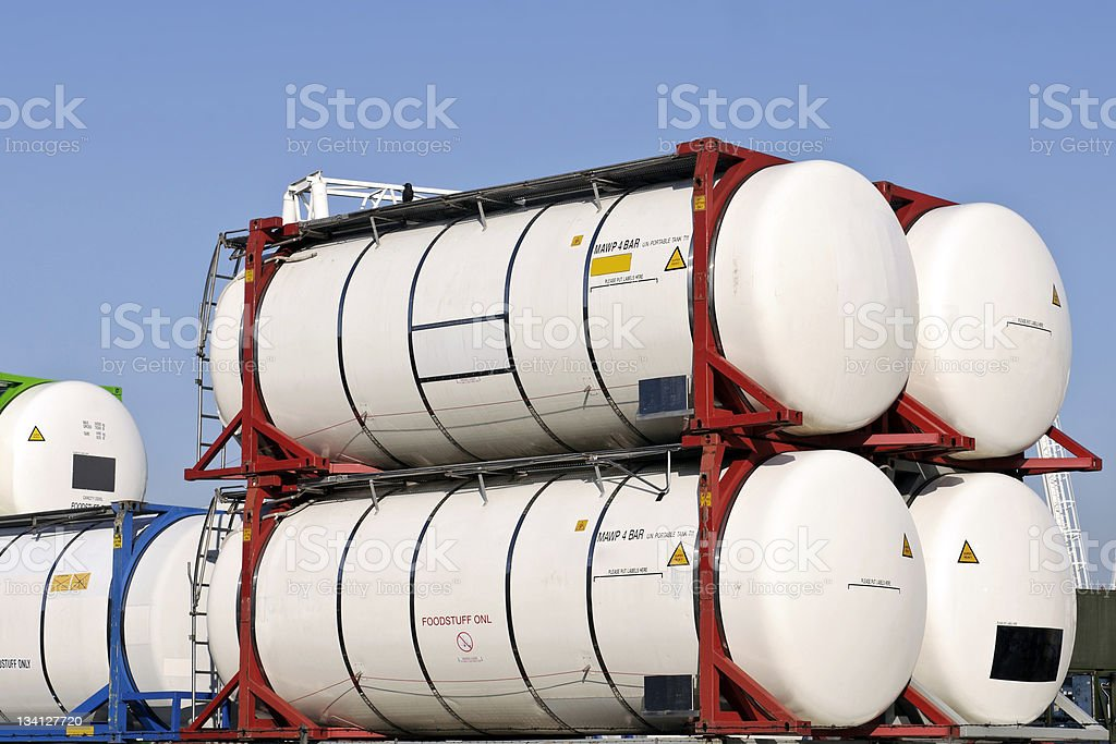 Close-up of four cylinder cargo containers with metal frame stock photo