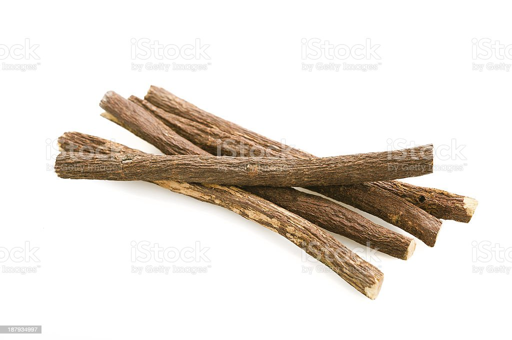 Close-up of four licorice sticks on a white surface stock photo
