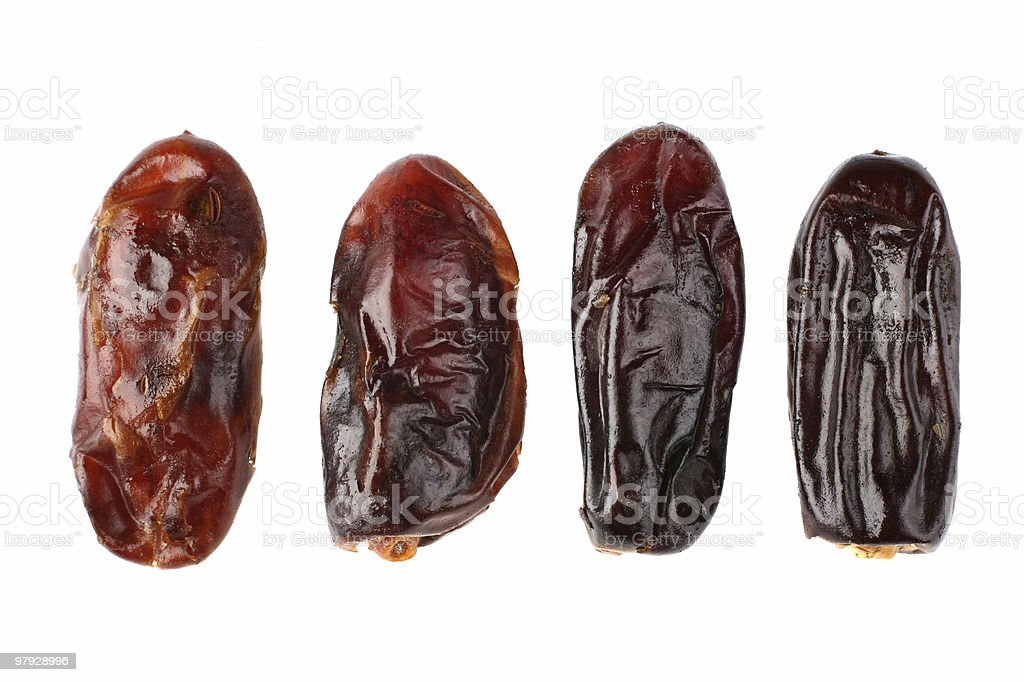 Close-up of four pieces of date fruit on white background stock photo