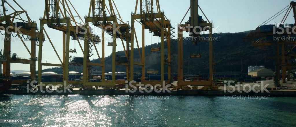 closeup of freighter cranes in Port stock photo