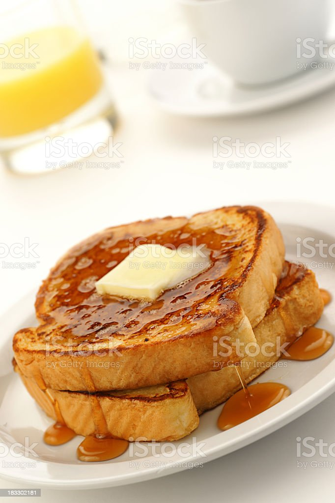 A close-up of French toast on a white plate stock photo