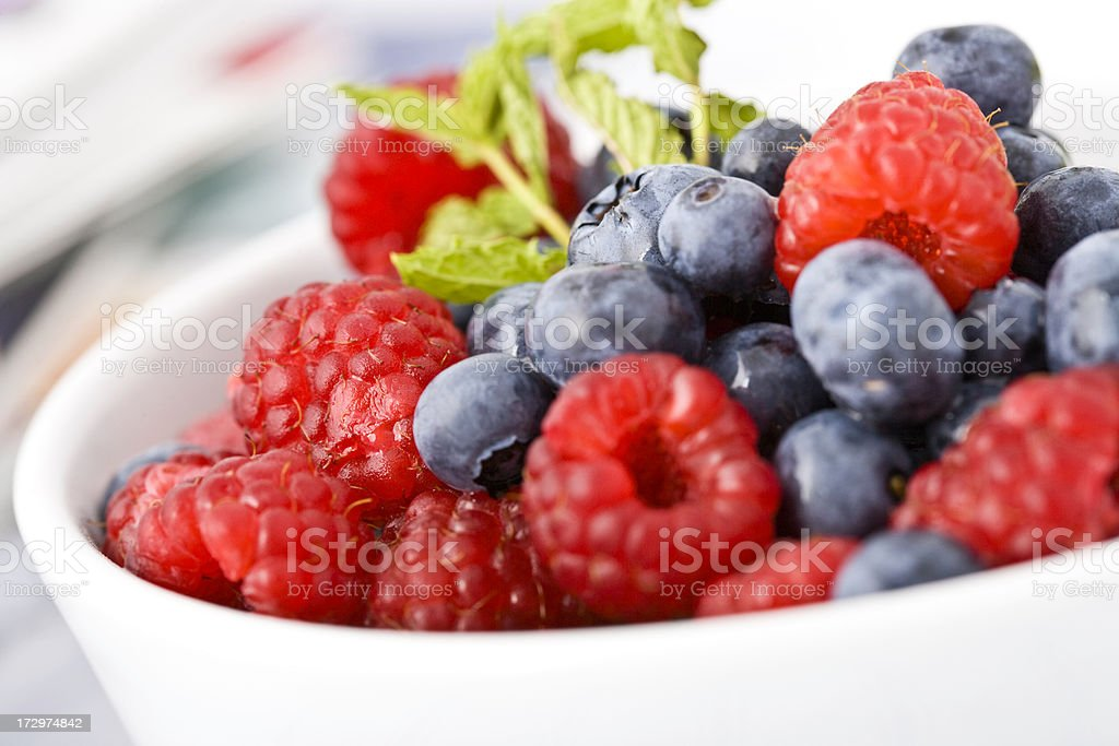 Close-up of fresh berries in a white bowl royalty-free stock photo